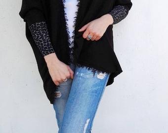 Cardigan with elasticized sleeves