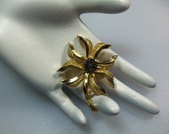 Vintage Textured Gold Tone Stylized Flower Pin Brooch with Black Enamel