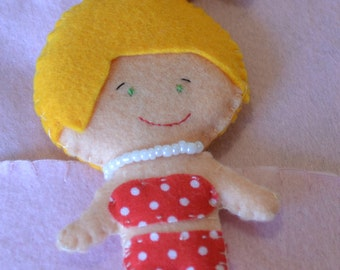 Felt doll. She can wear 1 white and red dress!