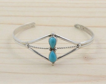 Zuni Native American bracelet inlaid with two Turquoise Silver for women.
