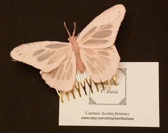 Comb with pink feather butterfly