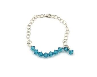 """Bracelet, Blue Swarovski Crystals and Sterling Silver, 7""""."""