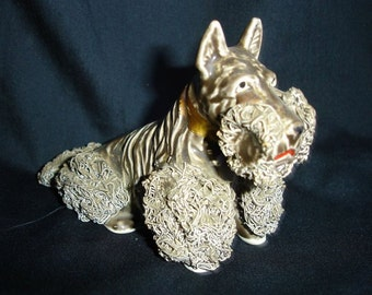 """Porcelain figurine, Brown dog Scottish Terrier sitting, decorations called ' Spaghetti """". Height: 3 1/2 in. Unbranded (c.1960)"""