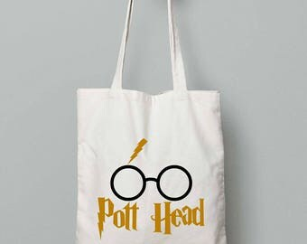Help Harry Potter and his friends search for the Deathly Hollows with this tote bag. Enjoy this book bag to carry all your Hogwarts Textbooks in.