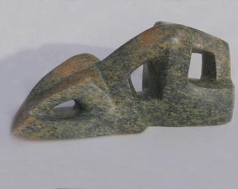 Almost Human: a  sculpture in Raindrop serpentine, abstract stone sculpture natural stone sculpture modern sculpture abstract beeld steen