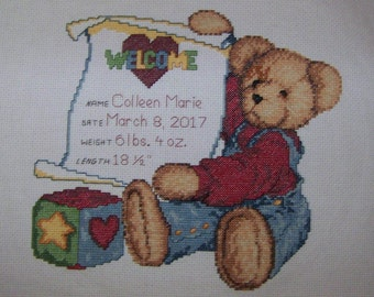 Counted cross stitch birth announcement customized for your baby.