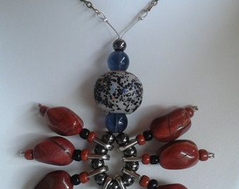 gem with Medallion beads strung on safety pins