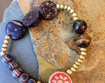 Gold and Wooden Beaded Bracelet with Salmon Colored Accent Bead