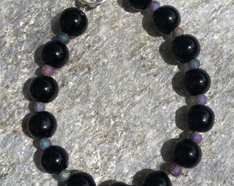 Black round beaded bracelet with multi colored ceramic beads