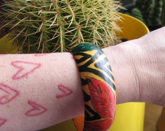 vintage hand painted bangle bracelet . wood carved leaf bracelet . yellow, green, red & black . wide chunky bangle