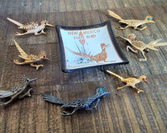 Lot of Seven Vintage Roadrunner Pins Goldtone and Silvertone with Glass Dish
