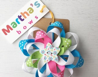 Bright pink, blue and green floral spotty double rosette hair bow