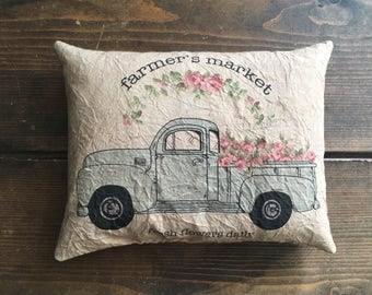 farmers market with flowers blue truck feed sack accent pillow