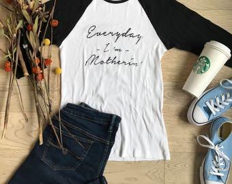 Everyday I am Mothering. Clothing. Women's T Shirts. T Shirts. Ladies Fit. Womens's Raglan Shirts. Baseball Raglan Shirts