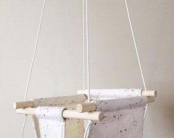 Gold, Silver and White Constellations Fabric Baby and Toddler Swing - Fabric and Wood Interior Swing