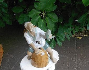 Vintage Oriental Mudmen Fisherman Figurine