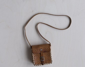 Vintage mini tooled leather bag