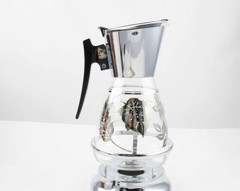 A 'Colony' Chrome Detailed Carafe With Curved Black Handle - Matching Stand - Useful and Usable - Glass Coffee Carafe  - Silver Leaf Pattern