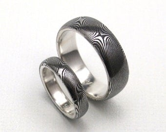 Stainless Steel Damascus Ring Wedding Set Lined in Sterling Silver.