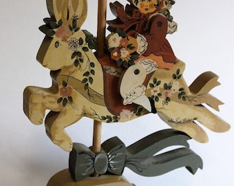 Lillian Renko Bledow handpainted and carved wooden carousel rabbit and rider, signed 1981