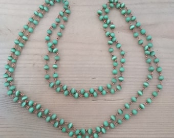Two vintage green catseye bead necklaces
