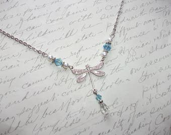 Dragonfly necklace with blue crystals and pearls