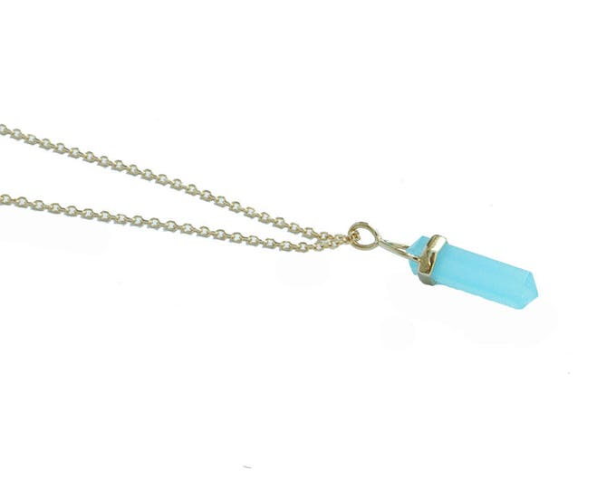 gold plated necklace with a turquoise pendant and chain