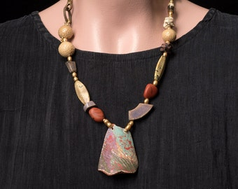 Quietly colorful asymmetrical necklace made of artisan beads and golden pearls, rustic beauty at its best, The Beauty of Broken Things