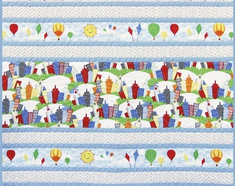 Baby or toddler quilt featuring Big City Friends by Wilmington, buildings, train, Tower of London, Eifel Tower,  Handmade in USA