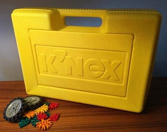 K'NEX yellow case filled with various building toys from 1997