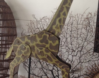 Metal girafe with pendulum