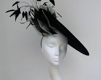Dramatic Black and white tilt disc hatinator in sinamay. Perfect for Weddings, Mother of the Bride, Royal Ascot. Hats Fascinators Hatinators