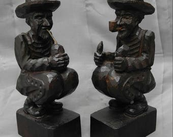 Old vintage pair of hand carved wooden figures smoking men bookends wood carvings
