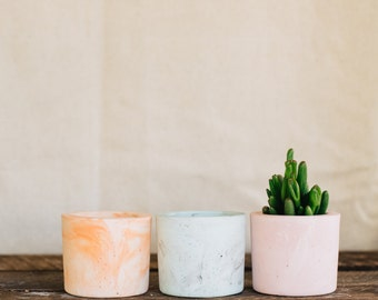 Mixed trio of coloured cement vessels, mini planter, cement tealight holder