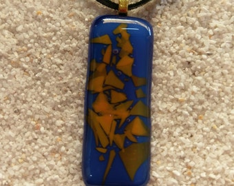 Large blue glass pendant with interesting orange highlights