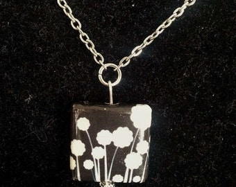 Black and white decoupage pendant necklace