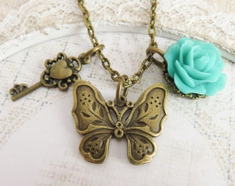 Butterfly necklace, bronze charm necklaces, turquoise flower jewelry, blue rose jewelry, gift for her, romantic jewelry, rustic