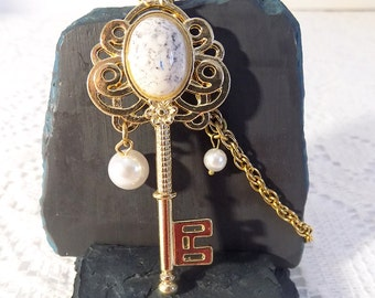 gold tone pearl key necklace