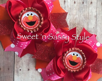 """Elmo Pink, Red and Orange 2- 4"""" Pigtail Bows"""