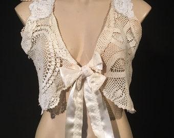 Vintage, boho style lace and crochet bolero. Satin bow tie front. Size Medium.