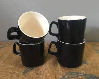 Sweet vintage set of 4 Mod black & cream ceramic coffee mugs with sleek lines and fun handles for Boho or Old Florida home!