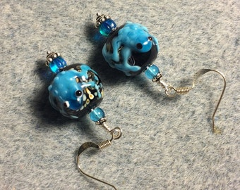 Black and turquoise lampwork frog bead earrings adorned with turquoise Czech glass beads.