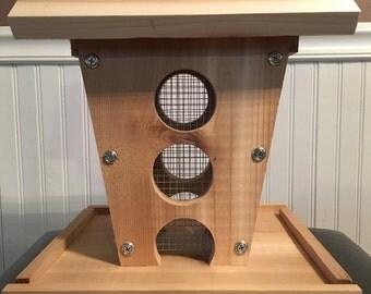 "Cedar ""holes"" birdfeeder"