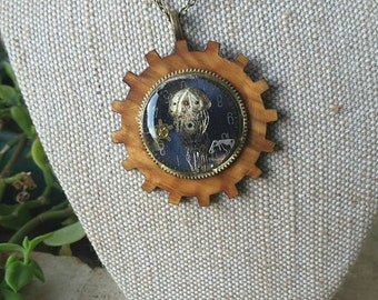 Steampunk necklace etching of jellyfish on vintage watchface,  with tiny watchparts. Set on Australian wood  Alchemy Alice Designs