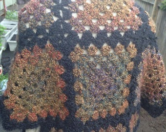 Black and multicolored crochet shawl very soft and warm. Big and heavy and oh so pretty!