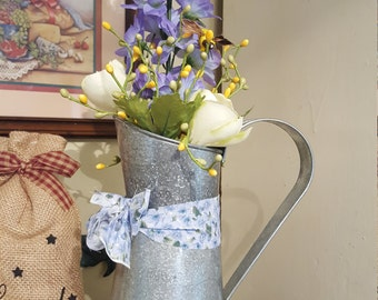 Pewter pitcher with flowers