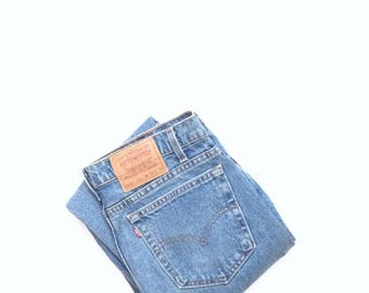 Levis 512. W32 L30, highwaisted, slim fit, tapered leg natural wash 100% cotton faded boyfriend jeans. Made in USA.