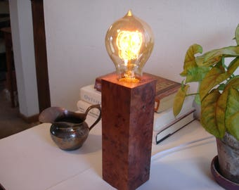 Great looking redwood burl table lamp with an IN-LINE DIMMER switch and an Edison old world bulb.