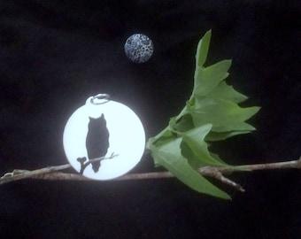 Silver moonlit owl silhouette