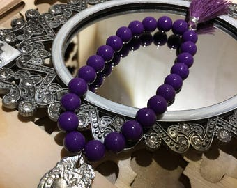 Royal Purple beaded flexible bracelet with an Authentic Mexican Pewter Sacred Heart Milargros charm and Purple Tassel.